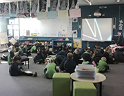 Brindabella classroom kids seat on the floor and study